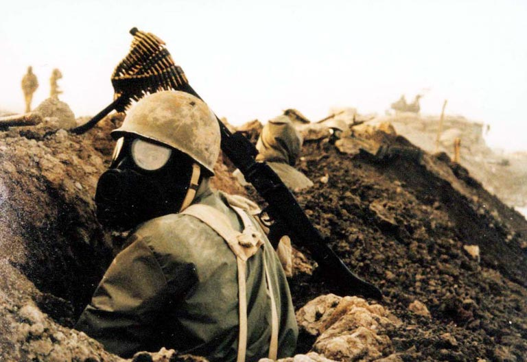 An Iranian Soldier Wears a Gasmask
